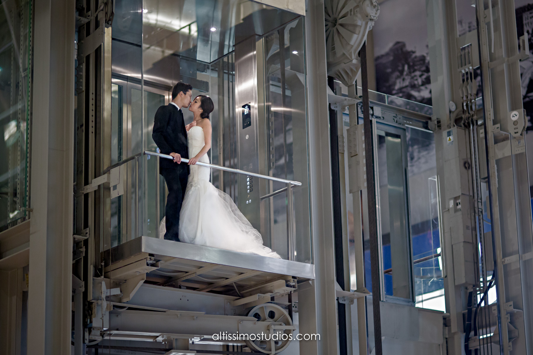 wedding picture taken in glass lift